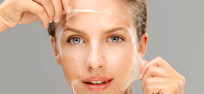 woman pulling clear layer off of face
