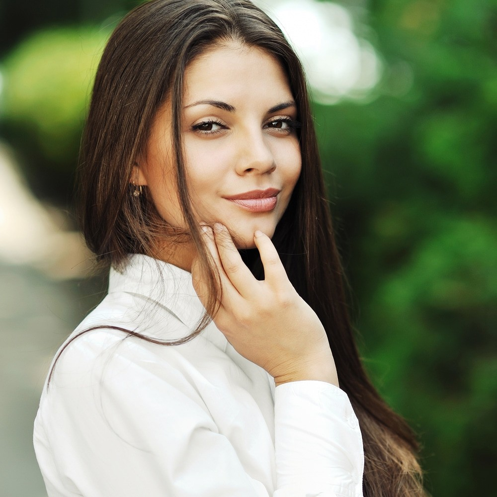 brunette with full face and a semi-smile or smug look, depending on your mood