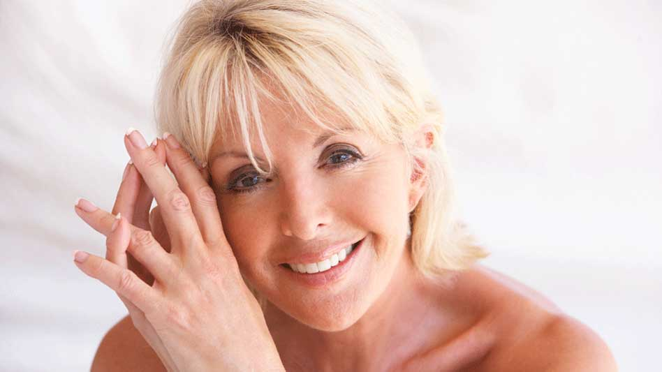 Beautiful blonde woman's face and hands