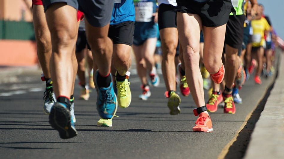 Runners' legs in race showing benefits stem cell or PRP treatments