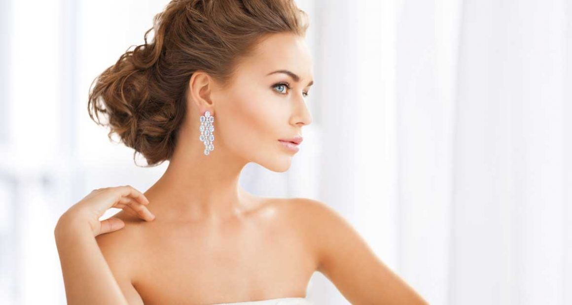 Beautiful woman with creamy skin wearing diamond earrings