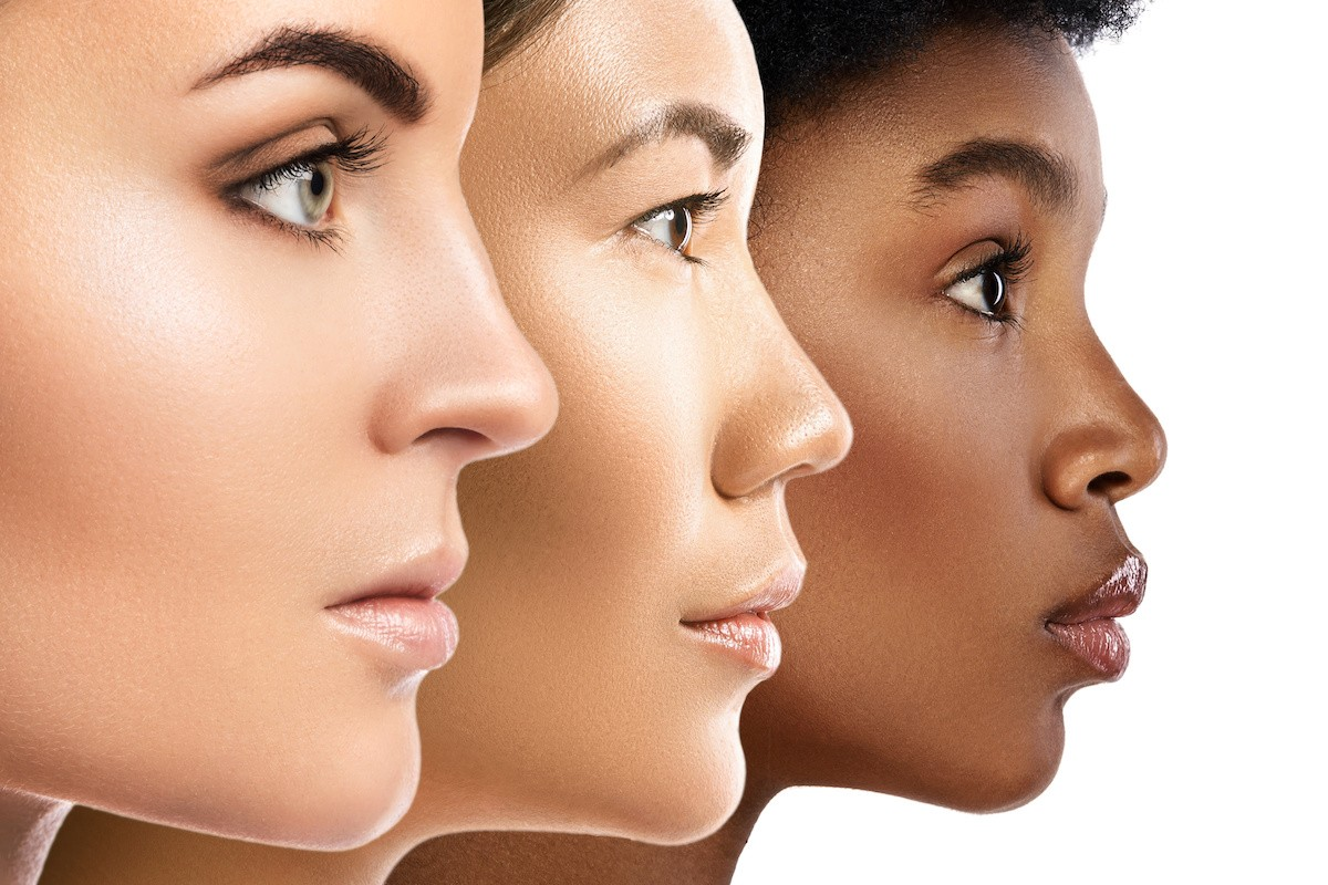 profiles of black, asian and caucasian facial skin